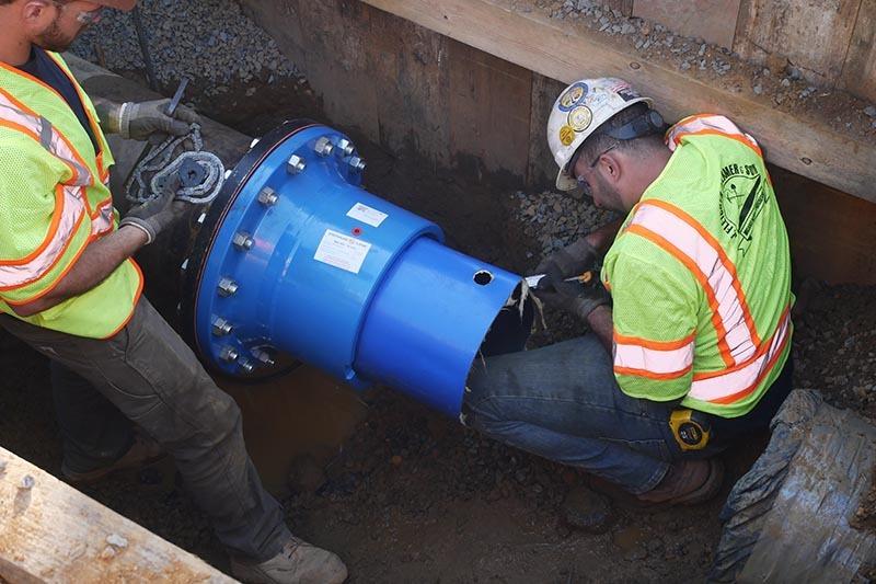 men working on pipeline rehabilitation project